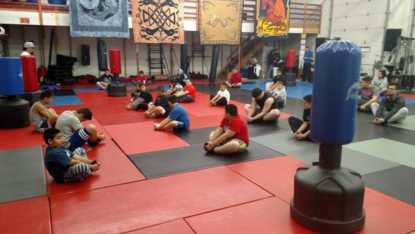 Students at the Pueblo Boxing Academy warm up before practice