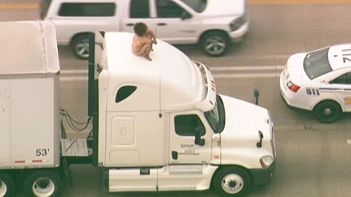 Naked woman dancing atop truck cab slows traffic in Houston