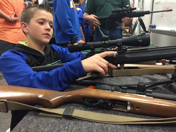 Students learn the safety and history behind guns at Craver Middle School before heading to a gun range.