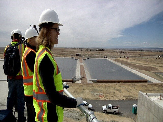 Colorado Springs City Councilwoman Jill Gaebler looks over the Edward W. Bailey Water Treatment Plant from atop 10 million gallon holding tank