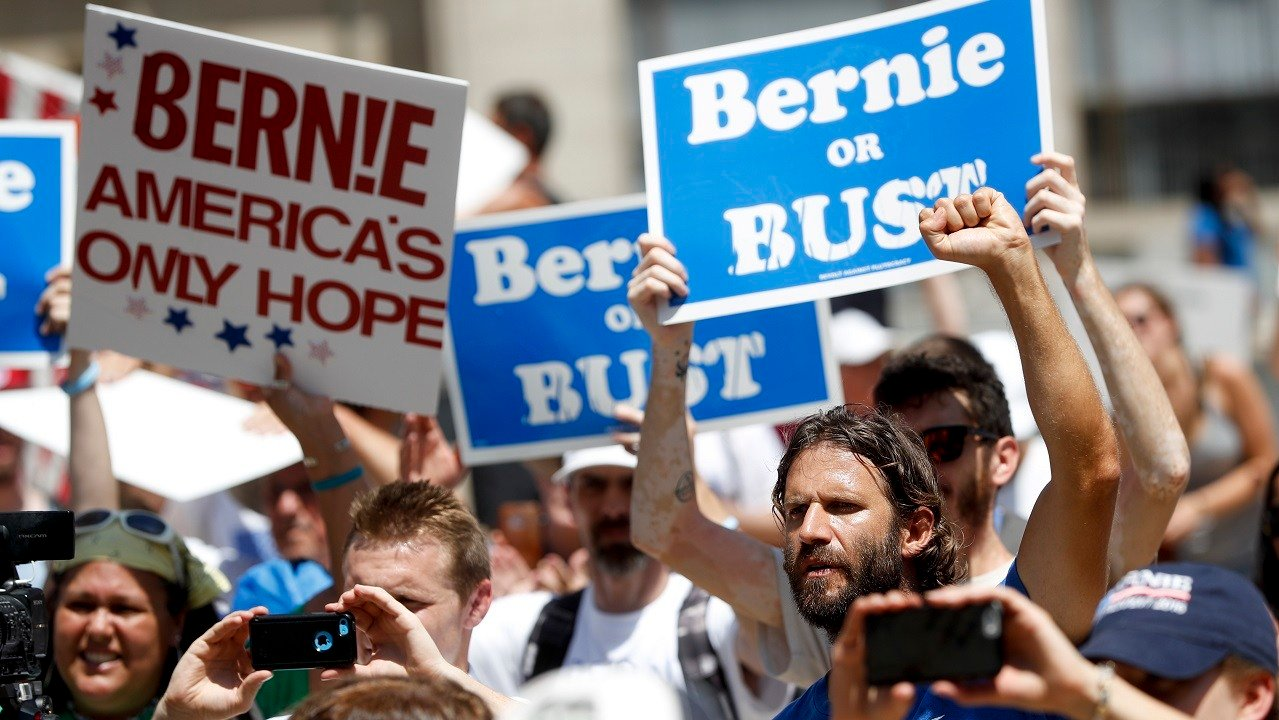 Supporters of Sen. Bernie Sanders, I-Vt., listen during a rally in Philadelphia, Tuesday, July 26, 2016, during the second day of the Democratic National Convention. (AP Photo/John Minchillo)