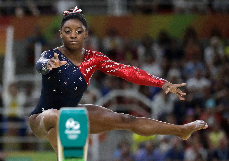Ledecky smashes world record to claim gold