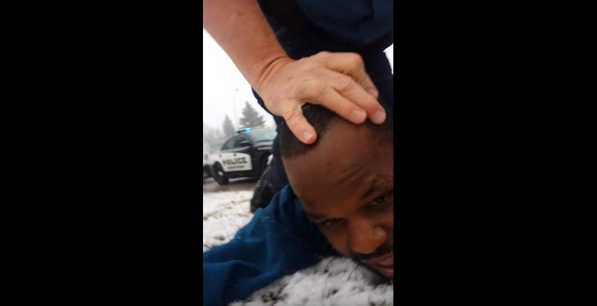Mr. Brown held on the ground by a Colorado Springs PD officer during a 2015 traffic stop.
