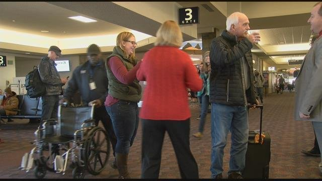 Travelers at the Colorado Springs Airport were treated to hot chocolate by Mayor Suthers. (KOAA)