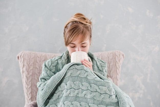 cold girl under blanket