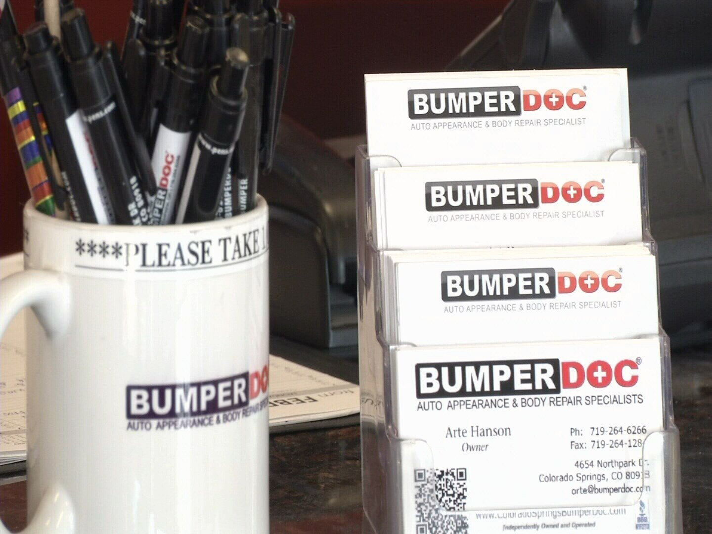 Business cards used to impersonate a local auto repairman. (KOAA)