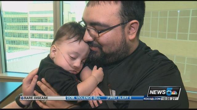 A father from Peublo comforts his son during care at Memorial Hospital in Colorado Springs. (KOAA)