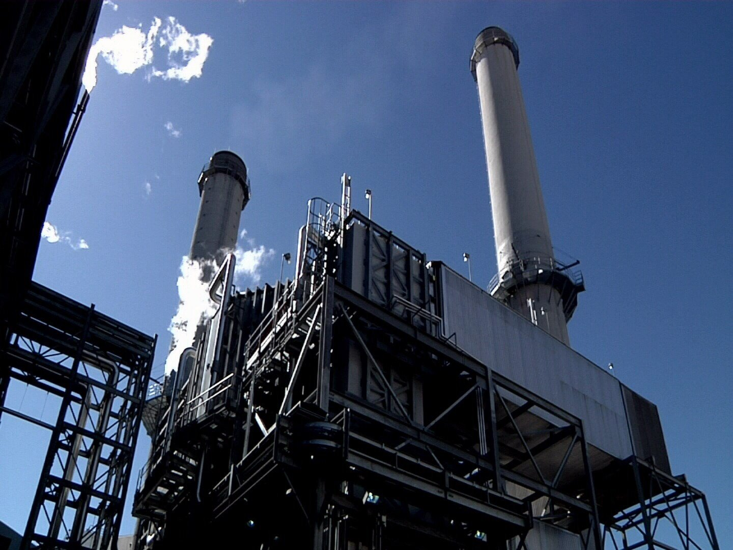 The emission stacks of units 6 and 7 of the Martin Drake power plant