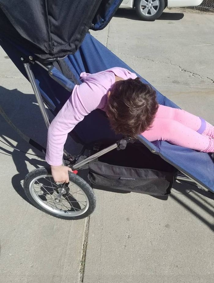 Katie tries out the wheels on her recovered stroller.