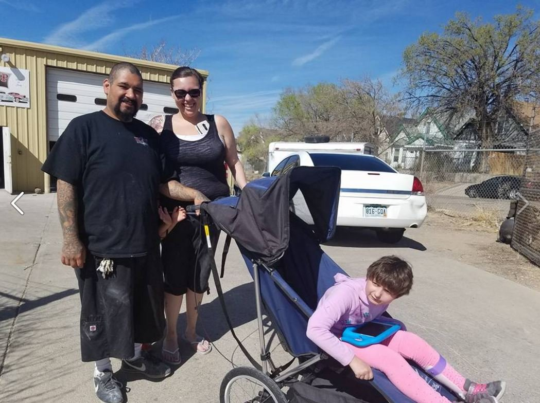 Katie with the people from Pin Up Customs who recovered her stroller.