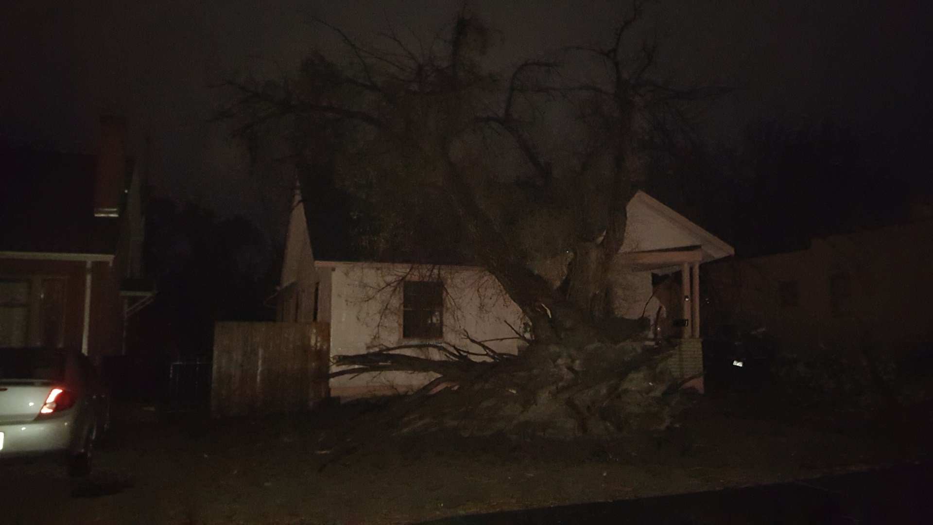A large tree uprooted onto a home in Pueblo.
