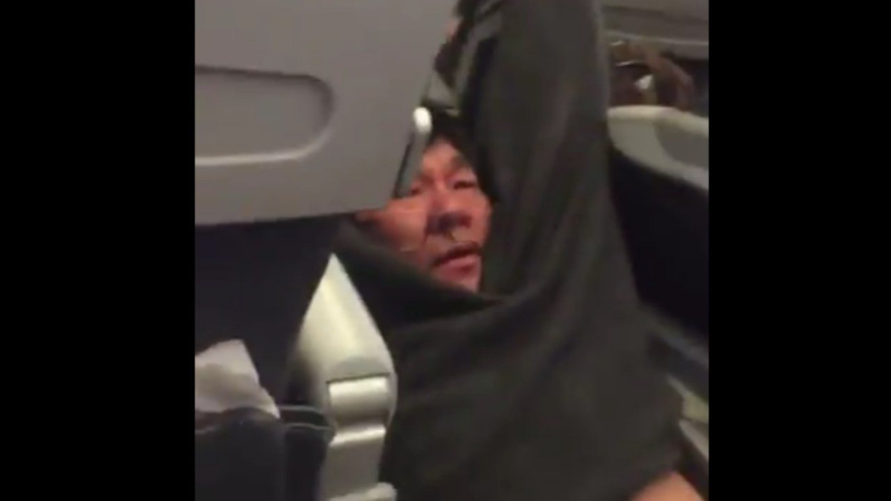 A United Airlines passenger is dragged off a flight. (Twitter: Jayse D. Anspach)