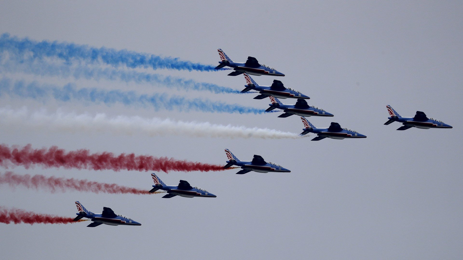 The French Air Force's Patrouille de France, led by an A400 Airbus support plane, performs a flyover the New York City skyline, Saturday, March 25, 2017, seen from Jersey City, N.J. The eight Alpha Jet formation is to commemorate the 100th anniversary of