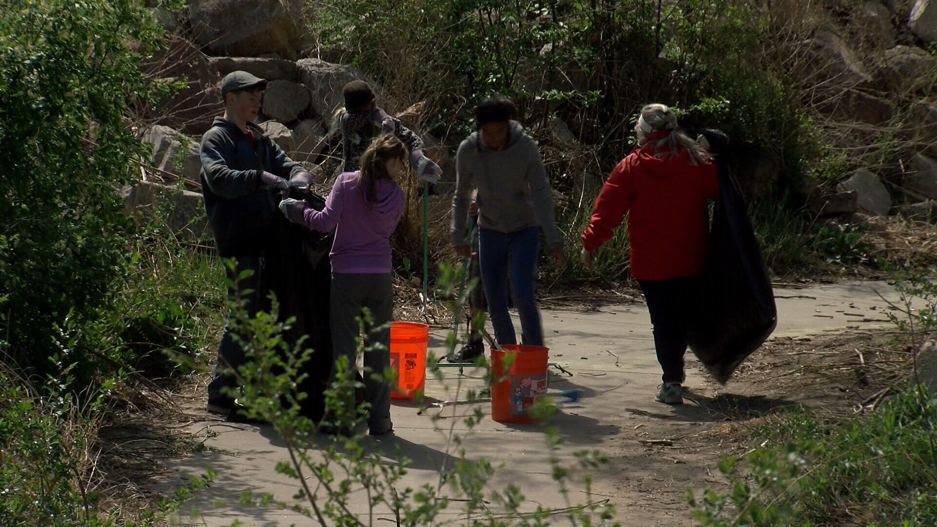 High school students clean up South Shooks Run Park. (KOAA)