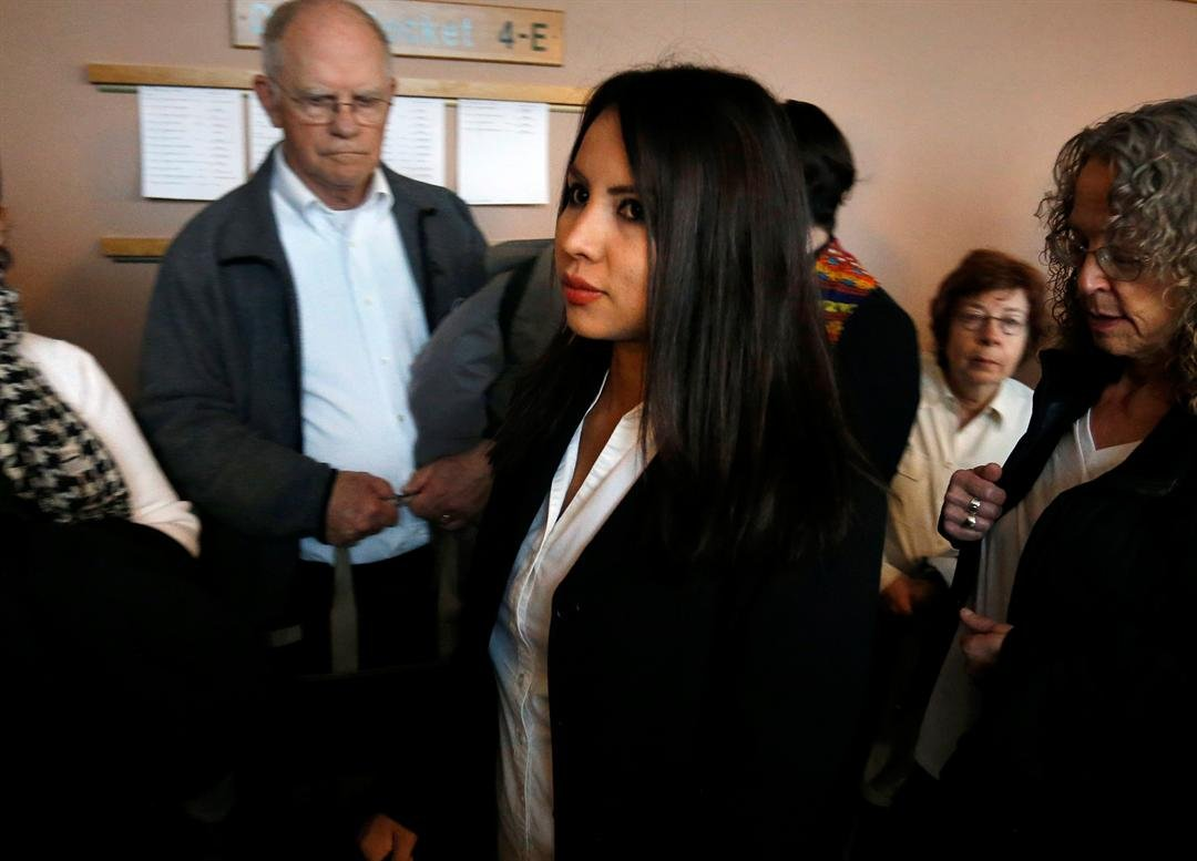 Sanctuary church resident Ingrid Encalada Latorre, center, enters a courtroom inside the Jefferson County Courthouse, in Golden, Colo., Wednesday, May 3, 2017. (AP Photo/Brennan Linsley)