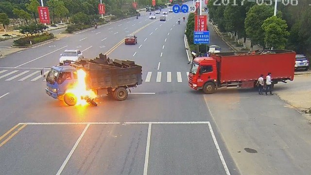 Watch speeding motorcyclist's fiery crash into dump truck