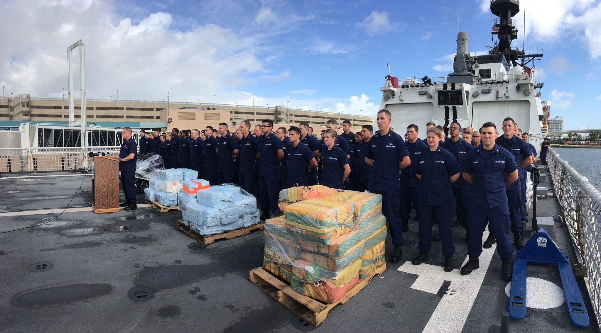 The crew of the USCG Cutter Hamilton with tons of cocaine seized in Pacific operations.