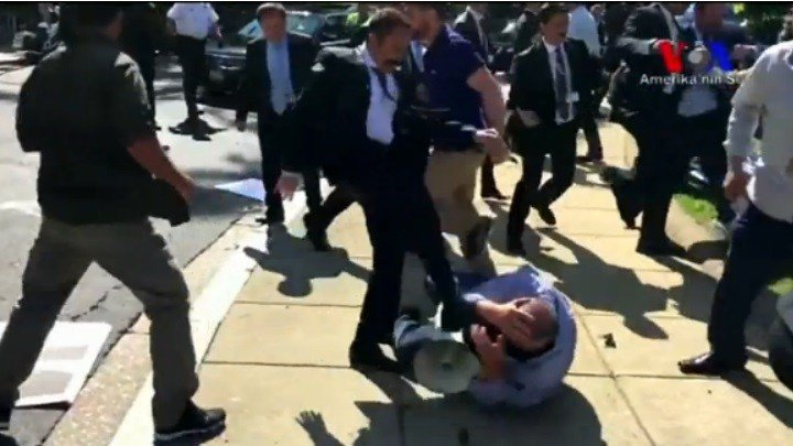 Turkish bodyguards hit and kick protesters outside an embassy in Washington D.C.  (Still image credit: Amerika'nin Sesi)
