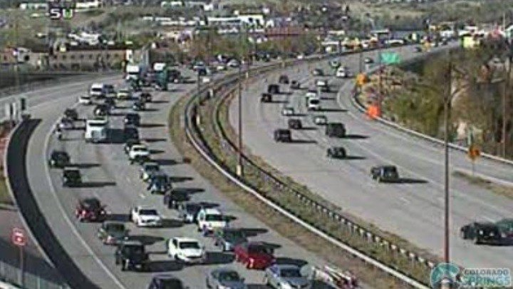 Traffic backed up on I-25 due to rocks on the roadway.