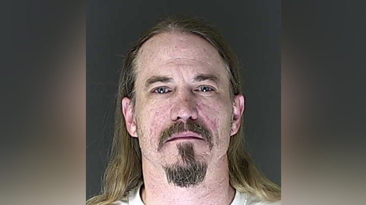 Fisher is booked on suspicion of assault and robbery charges after an argument turned violent at the Pikes Peak Brewing Company in Colorado Springs