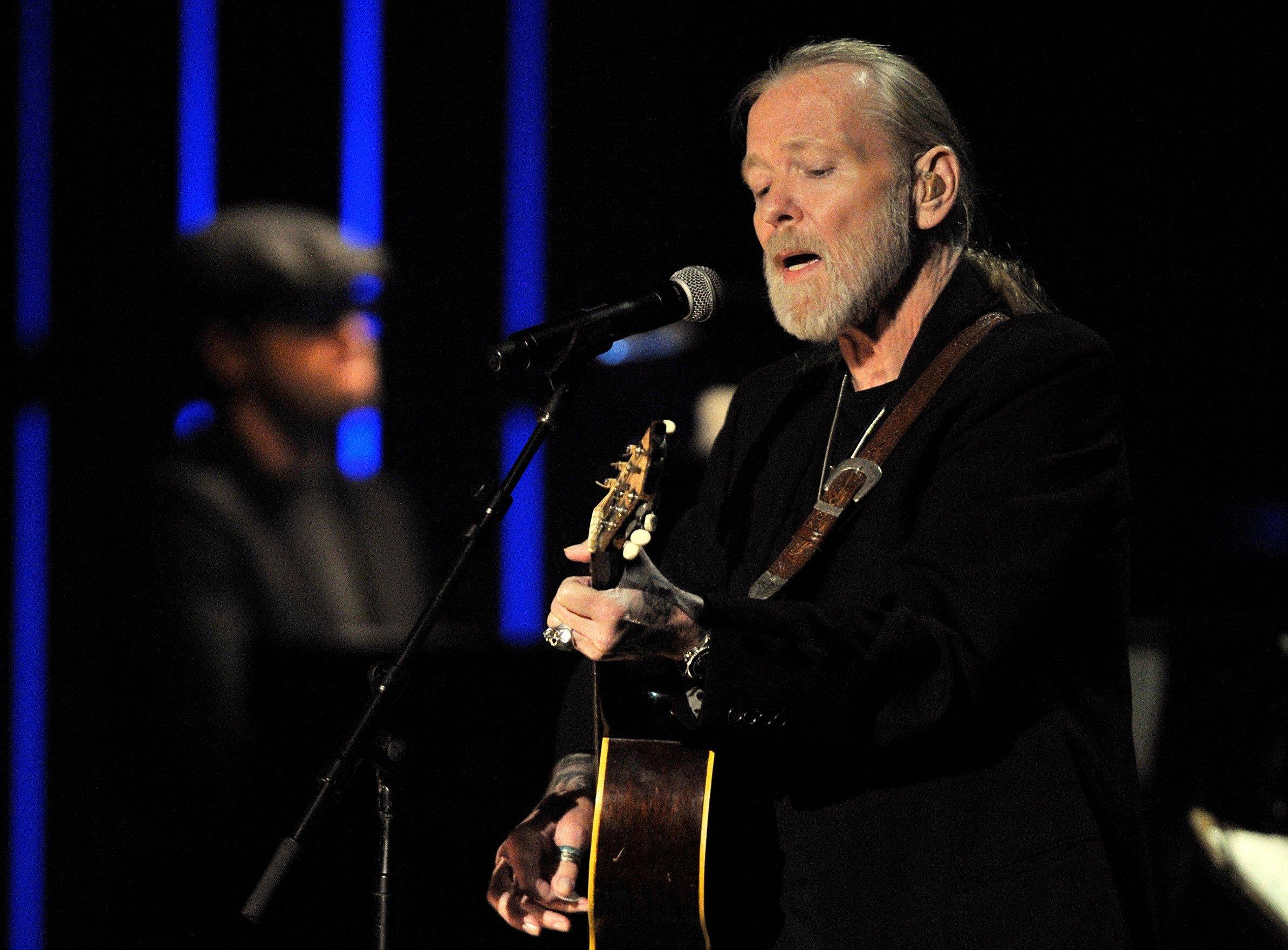 File photo shows Greg Allman performing at the Americana Music Association awards show in Nashville, Tenn. (AP Photo/Joe Howell, File)