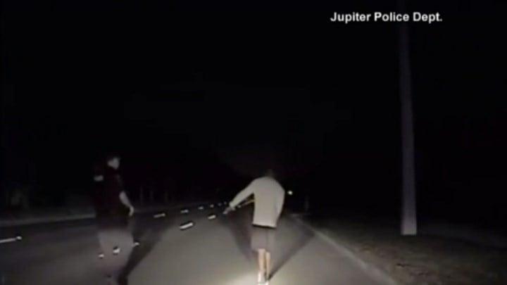 Dazed golf great Tiger Woods struggles to walk in police arrest video