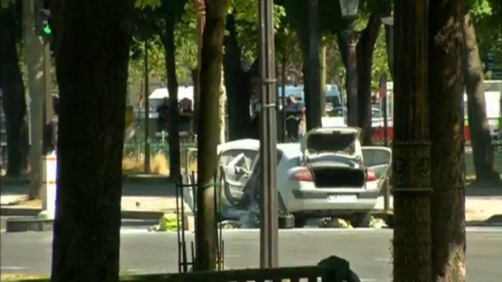 Paris police block off a car used in an attack on officers.