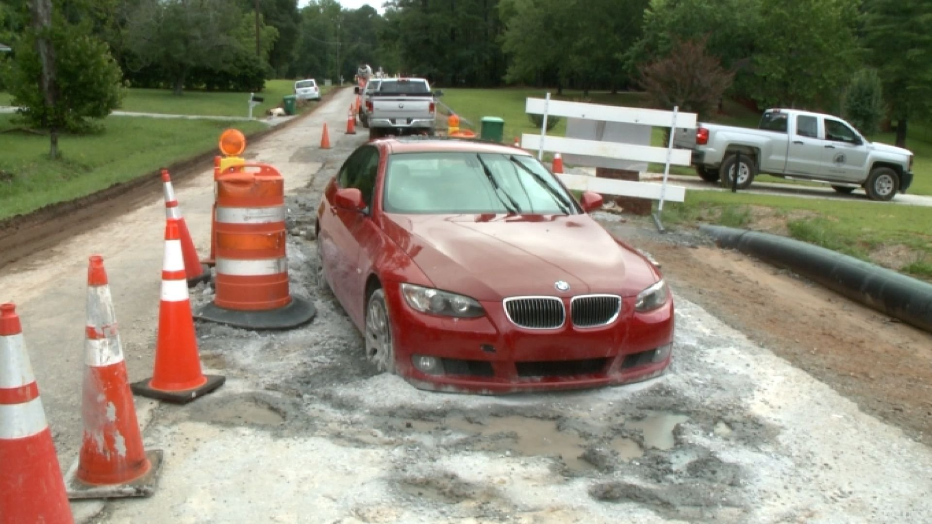 Georgia woman becomes stuck after mistakenly driving her BMW into wet concrete. WXIA's Ryan Kruger reports.