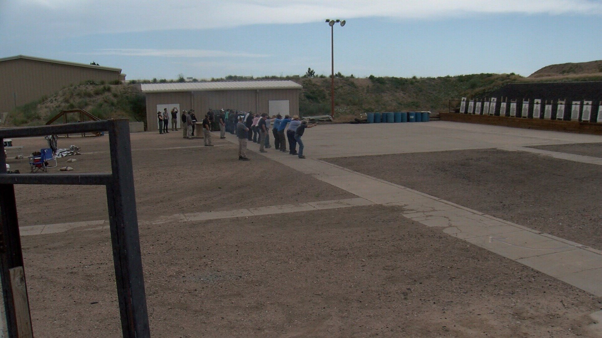 Teachers line up at the shooting range near the Weld County Sheriff's Office.