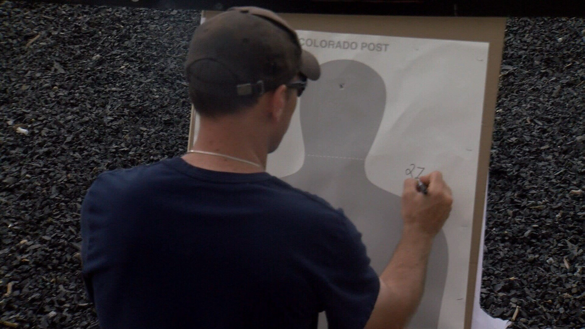 A teacher looks at his target at the shooting range near the Weld County Sheriff's Office.