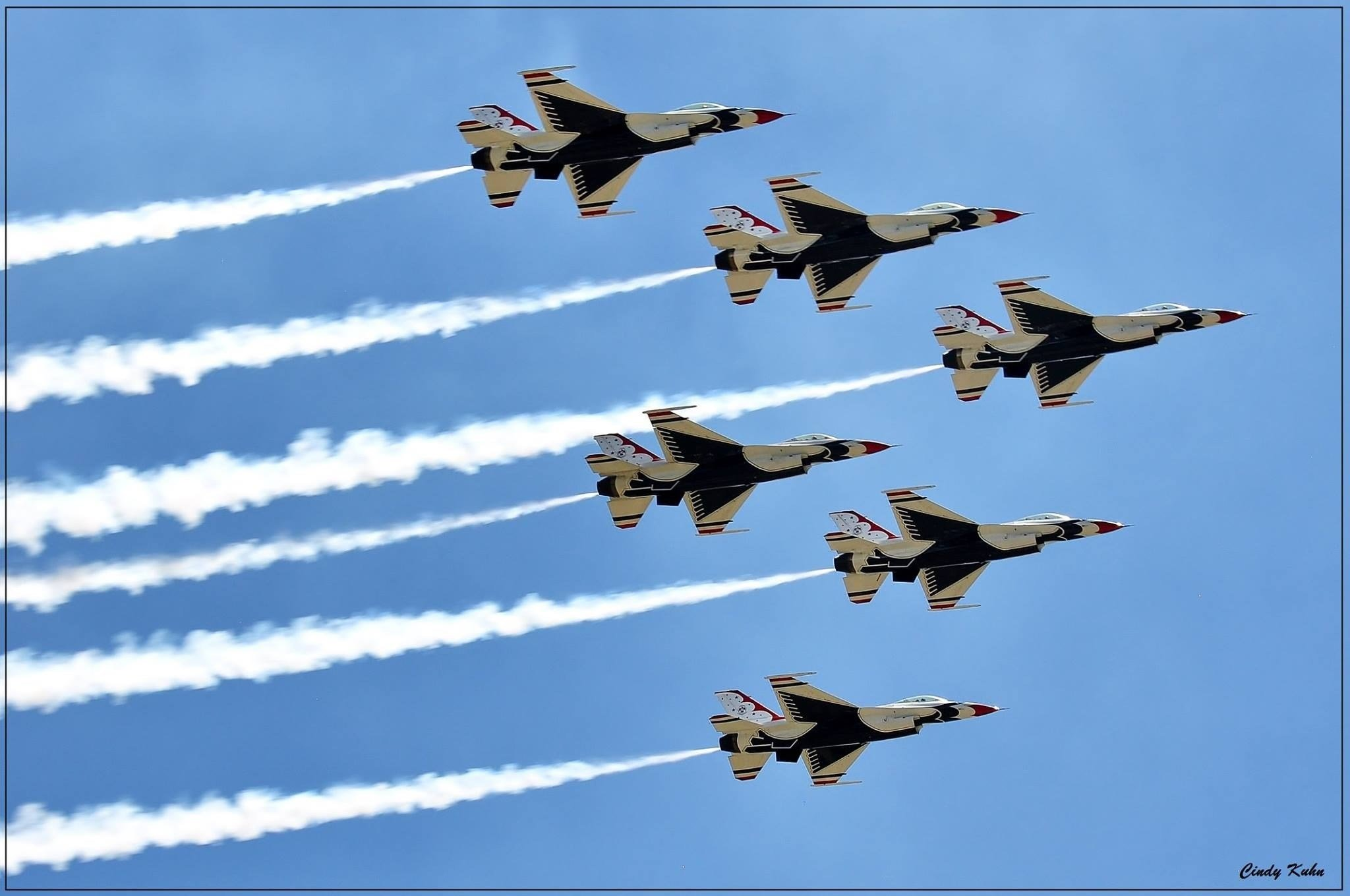 The Air Force Thunderbirds fly over Colorado Springs during the 2017 Air Force Academy Graduation.