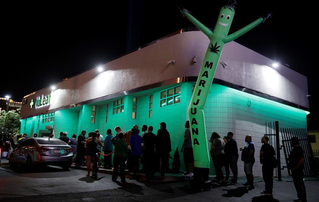 People line up at the NuLeaf marijuana dispensary, Saturday, July 1, 2017, in Las Vegas. Nevada dispensaries were legally allowed to sell recreational marijuana starting at 12:01 a.m. Saturday. (AP Photo/John Locher)