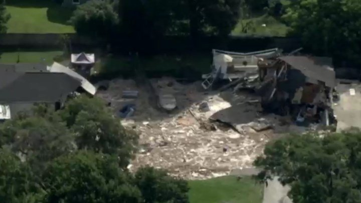 A large sinkhole opened up below homes in Land O'Lakes, Florida.