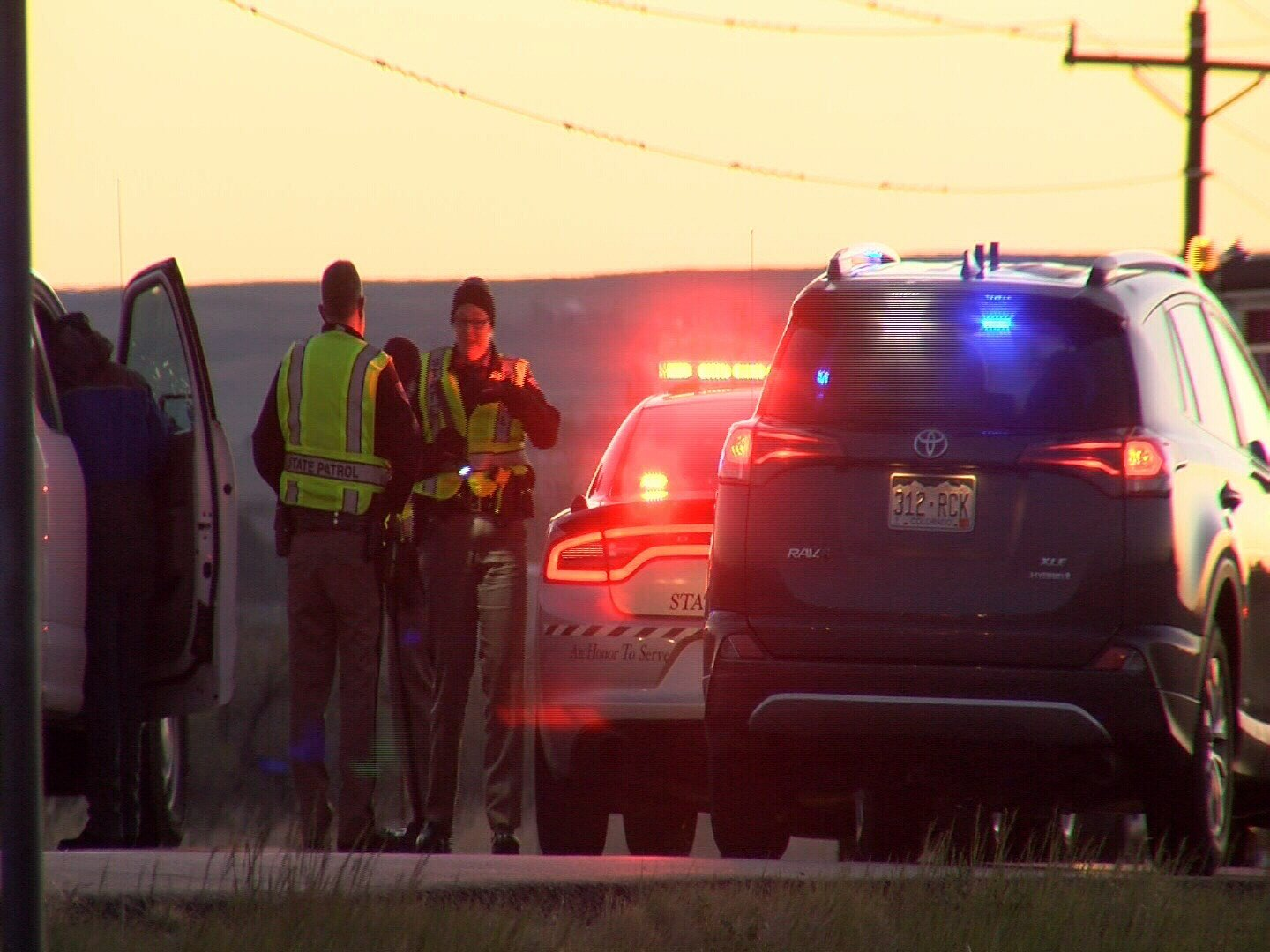 Colorado State Troopers attend the scene of a fatal head on collision along US 24 near Peyton on May 23, 2017