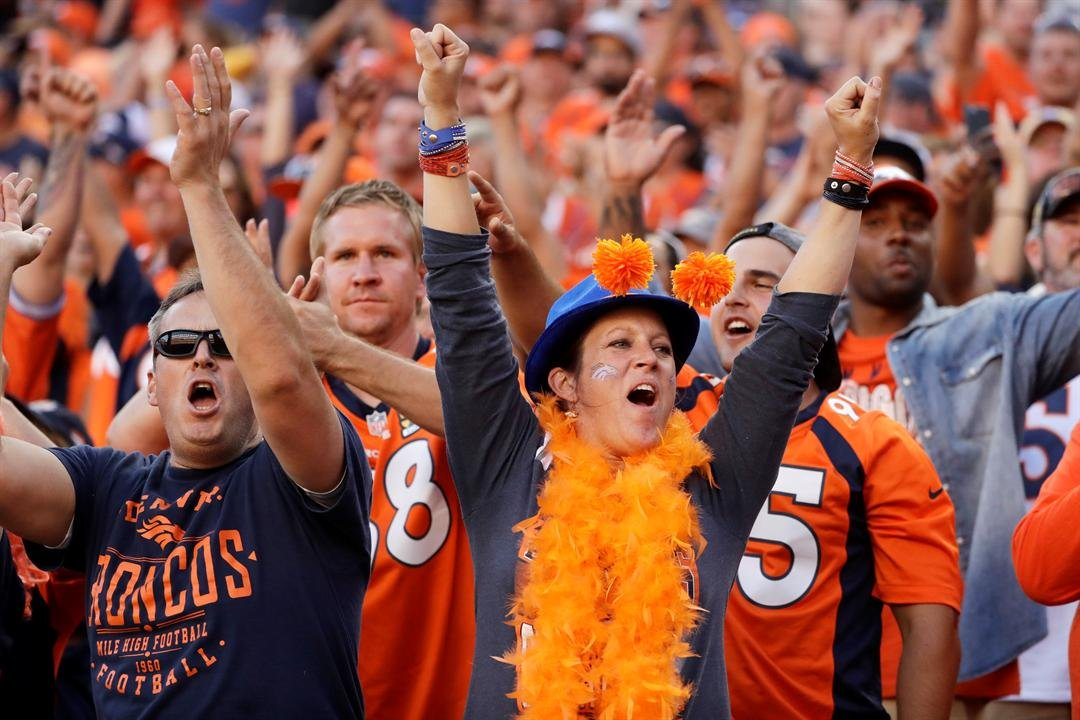 Denver Broncos fans cheer after a touchdown against the Indianapolis Colts during the second half in a NFL football game, Sunday, Sept. 18, 2016, in Denver.