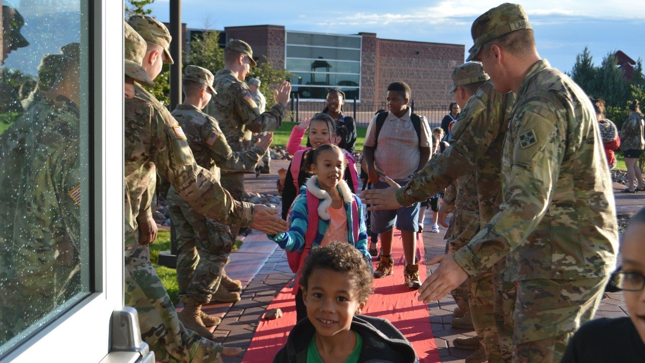 Students at Patriot Elementary welcomed back to school at Fort Carson.