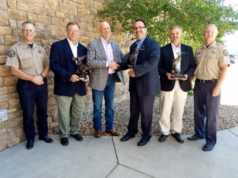 The Colorado Parks and Wildlife Commission honored three water engineers for their work to secure water for a permanent fish and wildlife conservation pool in John Martin Reservoir.