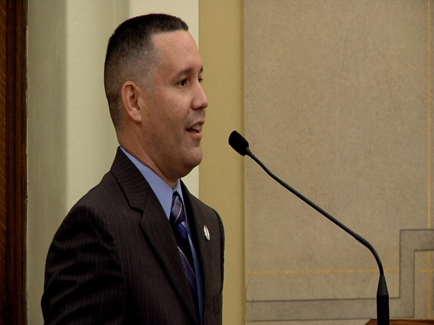 Sgt. 1st Class Eddie Medina greets the Pueblo County Board of Commissioners on the first day of his new fellowship