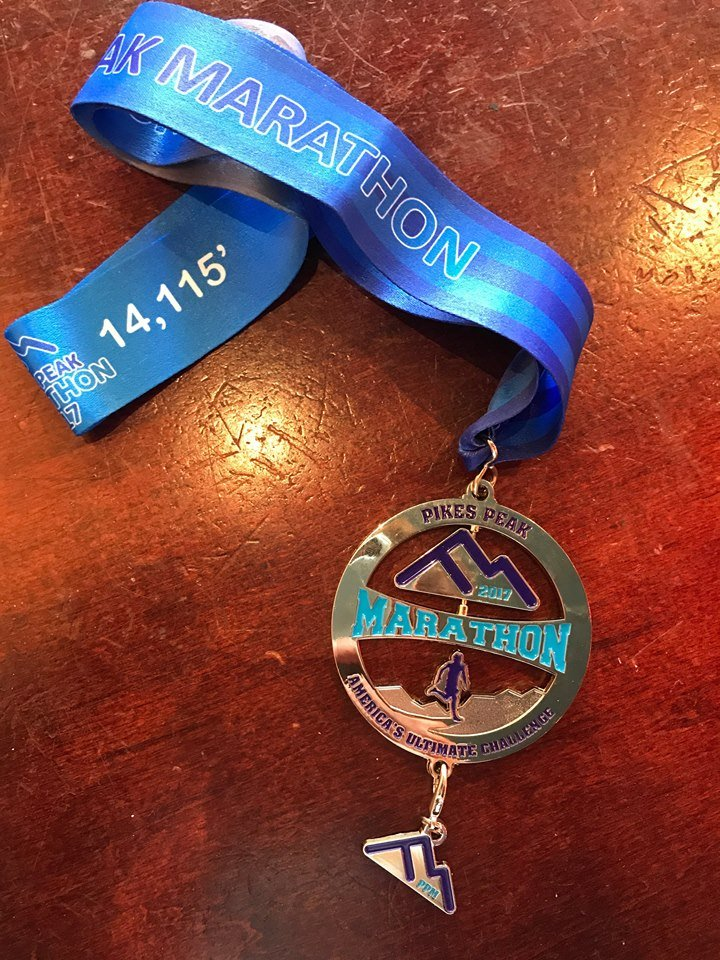 2017 finisher medals. The bottom can be clipped off and used as a keychain or charm.