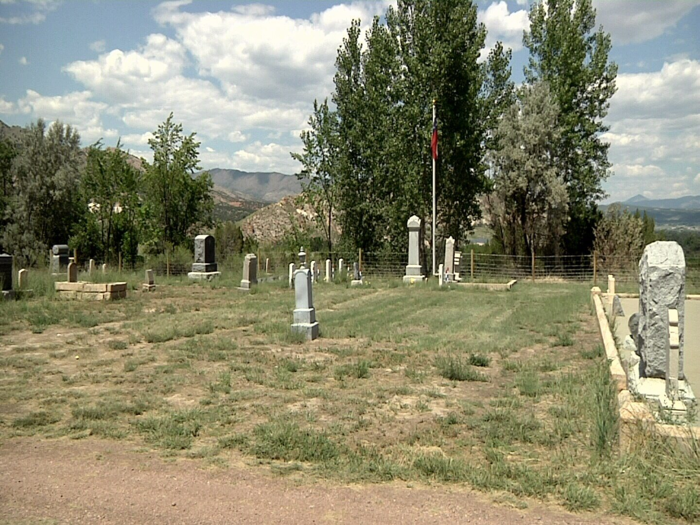 The flag of the Confederate States of America flies over the graves of Confederate Civil War veterans at Greenwood Cemetery in Canon City