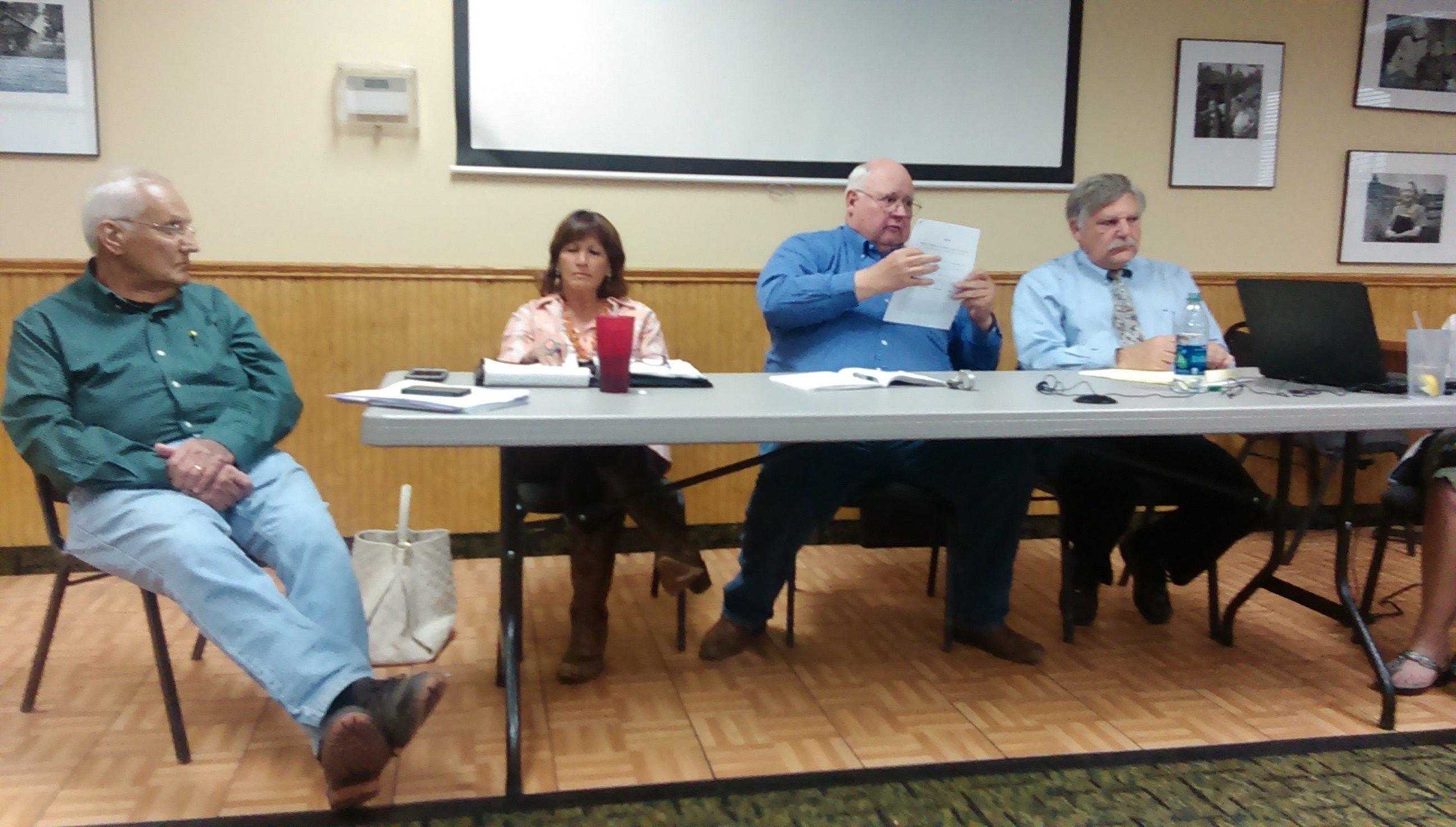 County Attorney Clint Smith, Commissioner Donna Hood, Commissioner Bob Kattnig and Commissioner Jay Printz. (Sangre de Cristo Sentinel)