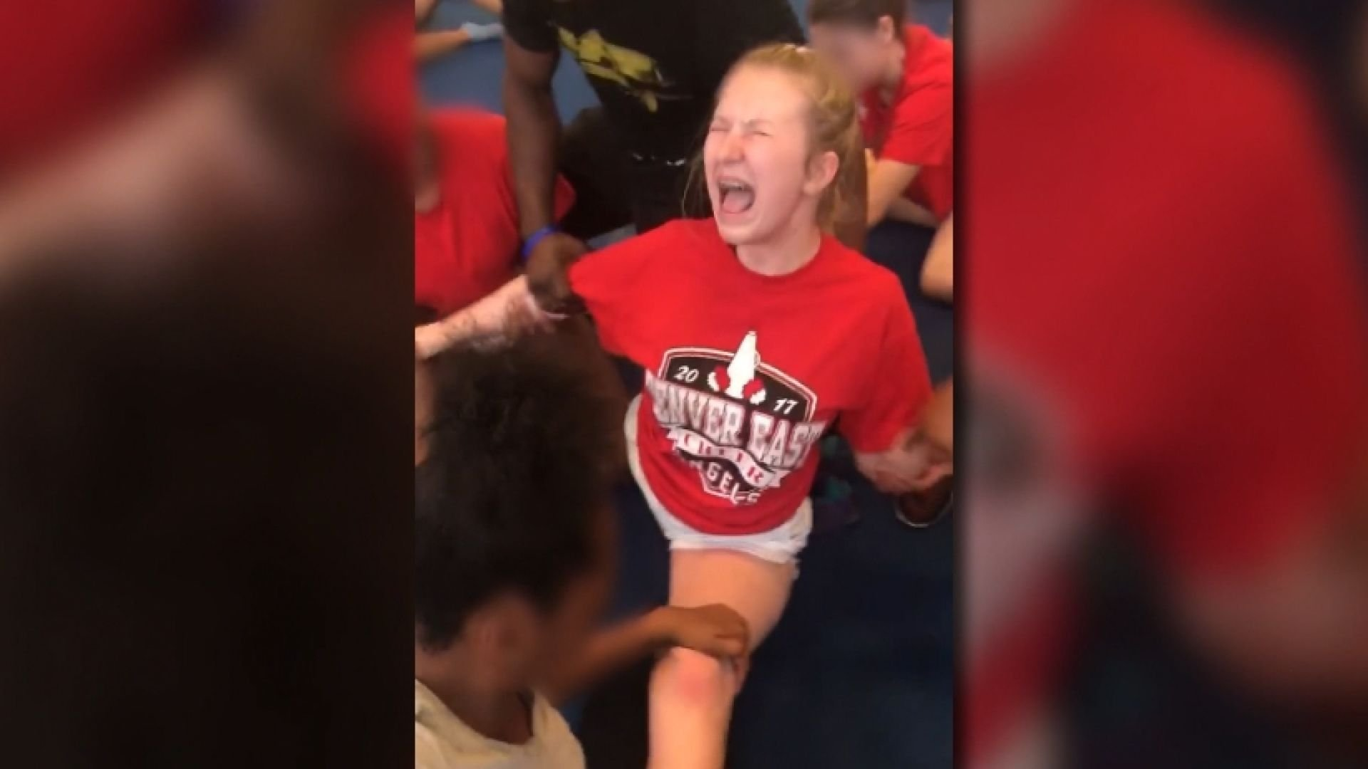 Video shows a cheerleader for Denver East forced to do splits. (KUSA)