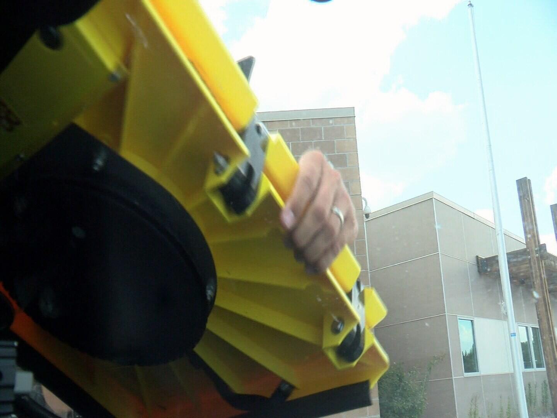 "Deputy Chris Dickey placing ""Barnacle"" on windshield"