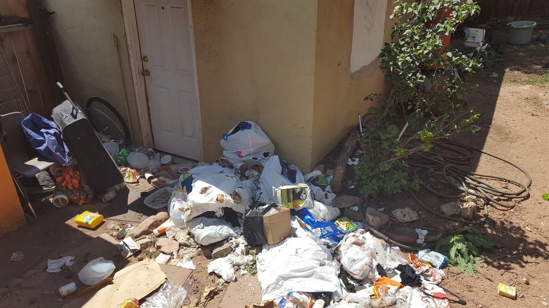 Trash left outside the home