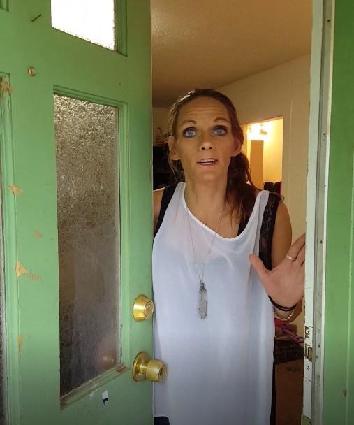 Squatter opening the door to Hawkins' home