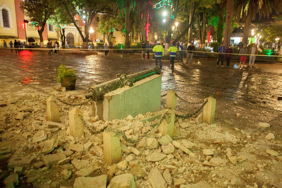 A monument surrounded by debris is cordoned off in the aftermath of an 8.1-magnitude earthquake in San Cristobal de Las Casas, state of Chiapas, Mexico, early Friday, Sept. 8, 2017.