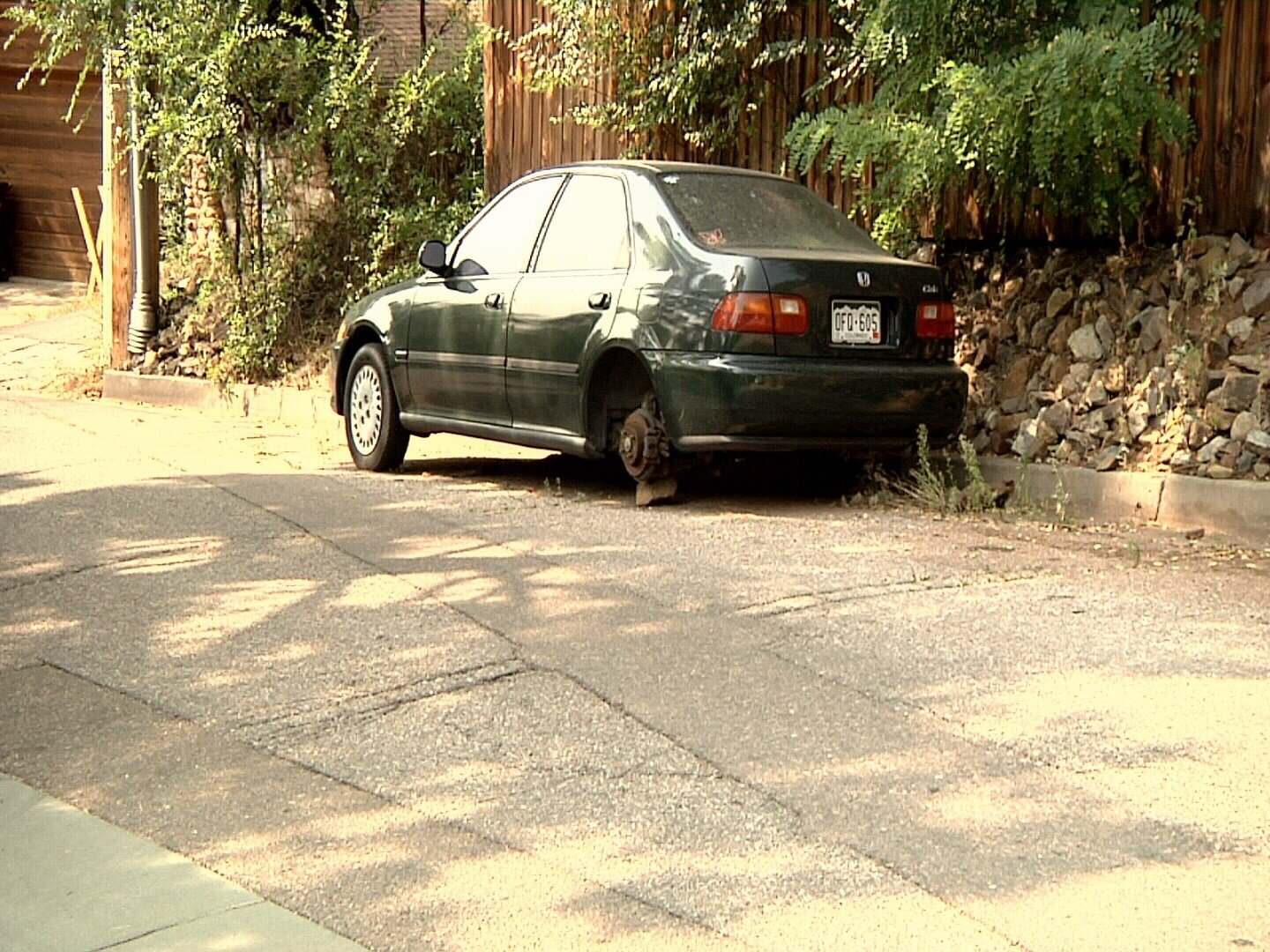 This abandoned car has been parked on Red Rock Avenue for at least three months