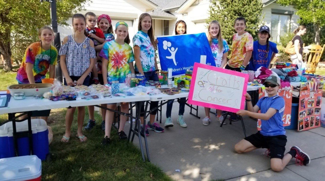 Cancer survivor Carter Gates, 12, and his friends have raised more than $5,000 for childhood cancer research by holding craft sales