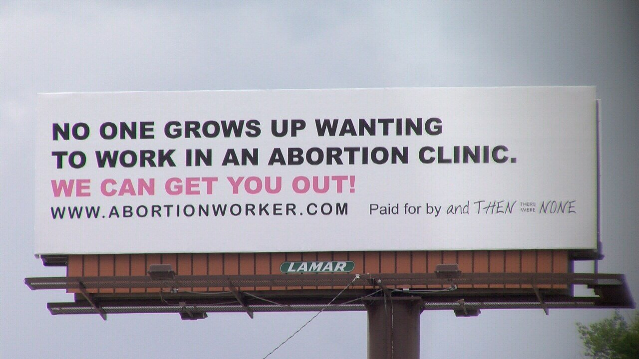 One of the billboards posted along I-25, urging people working at abortion clinics to quit their jobs.
