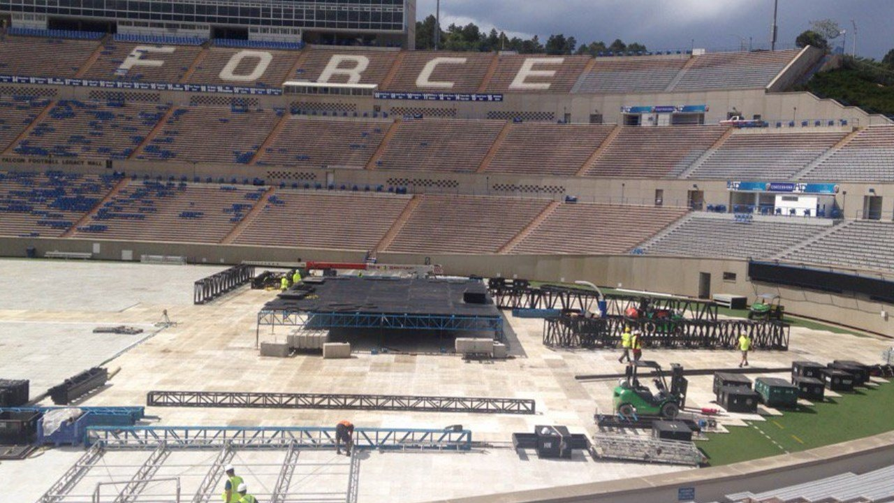 Crews begin the transformation of Falcon Stadium for the American Kickoff concert in Colorado Springs. (KOAA)